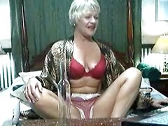 Sexy mature with short hair plays with her wet hole