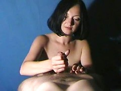 Amateur milf concentrates deeply on pleasuring his dick in a POV handjob