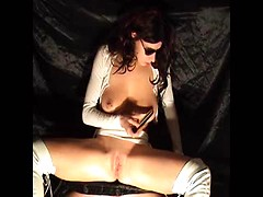 Brunette woman touching her pierced nipples and masturbatinh bald pussy by sex toy
